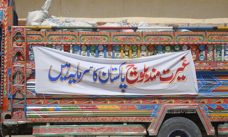 Banner on truck carrying relief goods in Awaran reads: 'Honourbale Balochis are Pakistan's asset'. – Photo by author