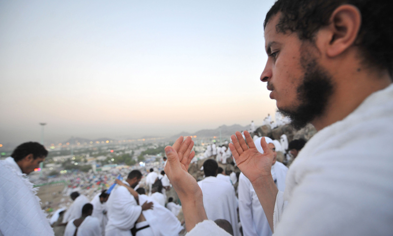 A Muslim pilgrim prays on top of Mount Arafat, near the holy city of Mecca, ahead of the hajj main ritual, on October 14, 2013. —AFP Photo