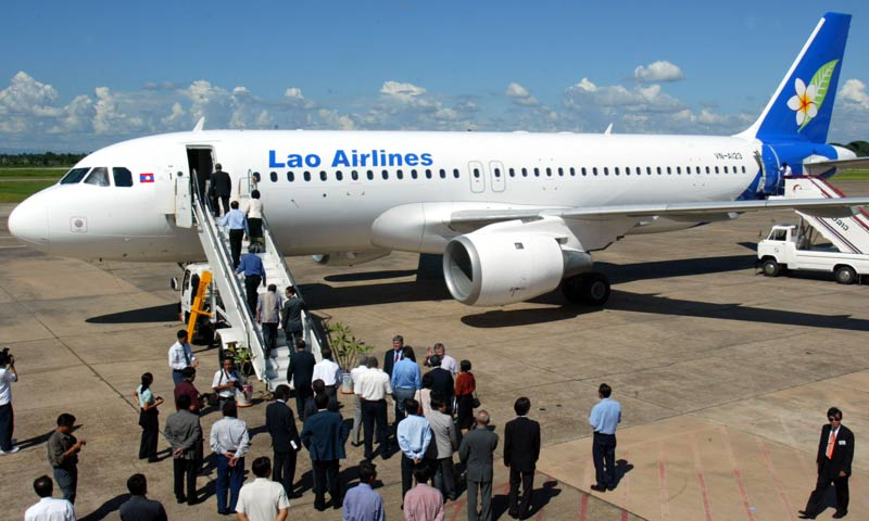 A file picture shows passengers boarding the first Airbus A320 flight of Lao Airlines at the Vientiane International Airport, on July 16, 2003. -AFP Photo