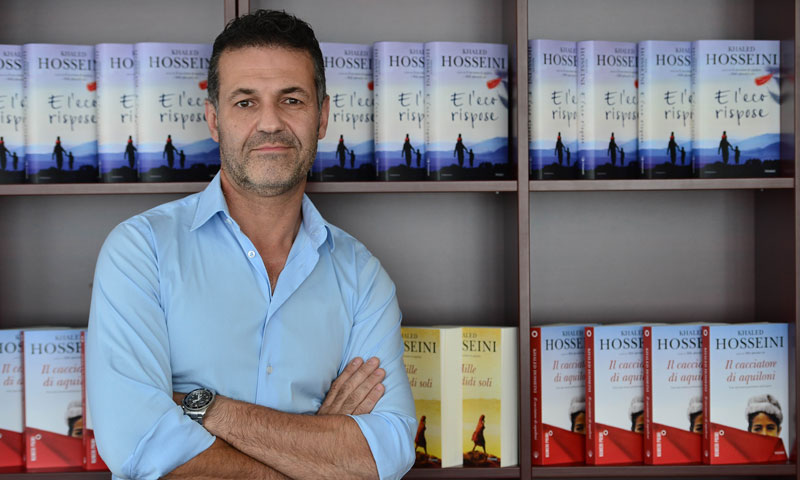 "Afghan-born US novelist Khaled Hosseini poses after an interview to promote the release of his book  ""And the Mountains Echoed"" on October 17, 2013 in Milan. — Photo by AFP"