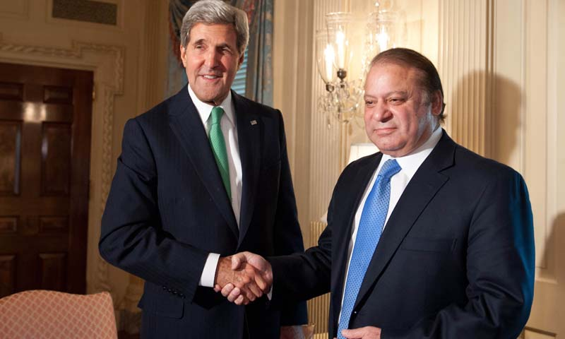 US Secretary of State John Kerry shakes hands with Pakistani Prime Minister Nawaz Sharif at the State Department in Washington on October 20, 2013. Sharif arrived in the United States for talks, with the Afghan peace process and the prickly issue of Washington's drone campaign likely to top the agenda. Sharif meets President Barack Obama on October 23 with Washington keen to press the Pakistani premier to help faltering efforts to secure peace between Kabul and the Afghan Taliban. — Photo by AFP