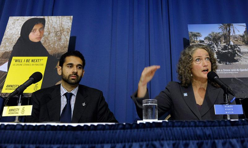 Letta Tayler, senior counter-terrorism researcher at HRW, accompanied by Mustafa Qadri, a Pakistan researcher at AI, talks about the findings of two new reports on US drone on Tuesday in Washington. — AP Photo