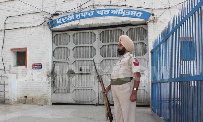 A policeman stands guard at the central jail in Amritsar city in Punjab, India. — File Photo