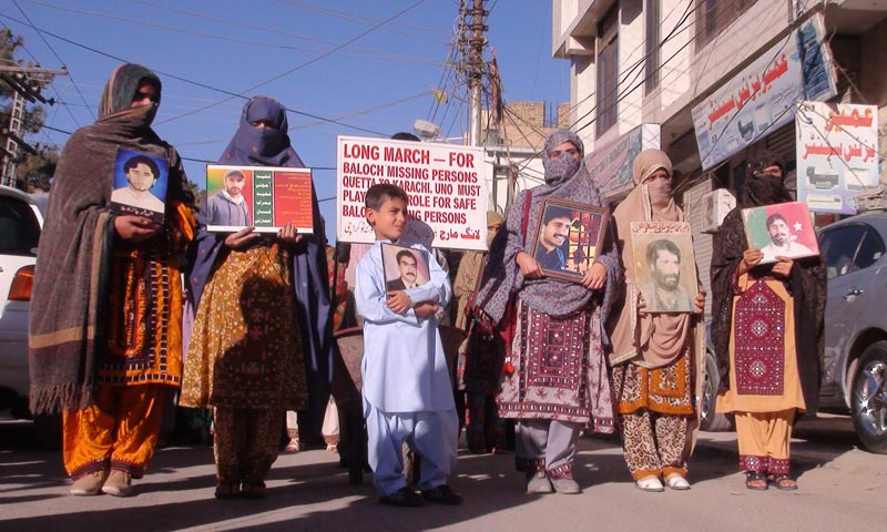 Protesters and long march participants holding slogans demanding the recovery of missing persons. -Photo by Syed Ali Shah