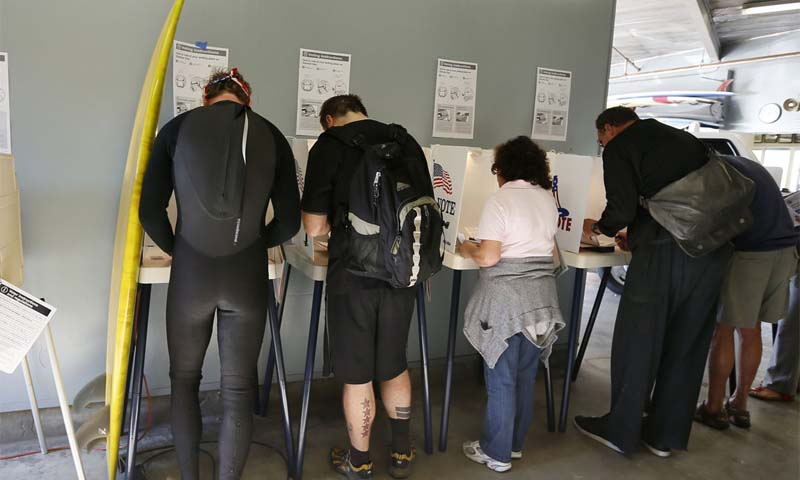 US voters line up to cast their vote on Election Day. — Photo Reuters