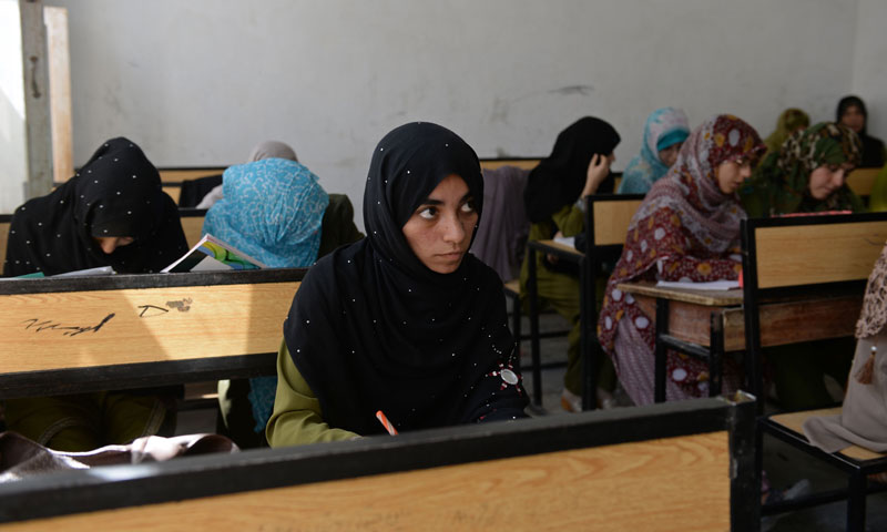 Shamsia Husseini (C) looks on as she attends a teacher training class at Mirwais Mena school in Kandahar city. — Photo by AFP