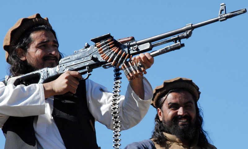 This file picture taken on Nov 26, 2008, shows Pakistani Taliban commander Hakimullah Mehsud (L) firing from a rifle. — AFP Photo
