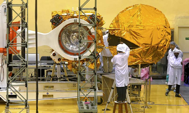 In this file picture taken on September 11, 2013, scientists and engineers work on a Mars Orbiter vehicle at the Indian Space Research Organisation's (ISRO) satellite centre in Bangalore in Bangalore. India began a countdown on November 3 to the launch of its most ambitious and risky space mission to date, sending a probe to Mars which was conceived in just 15 months on a tiny budget. — Photo AFP