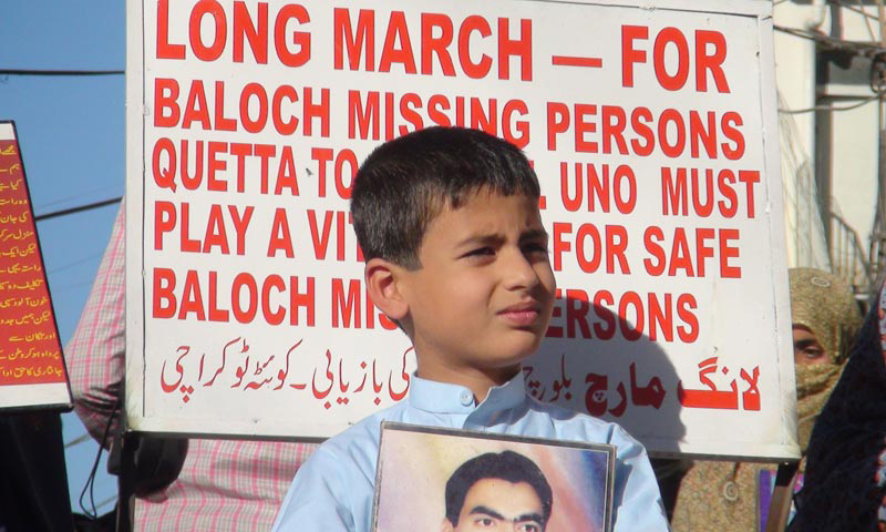 Protesters and long march participants holding slogans demanding the recovery of missing persons.