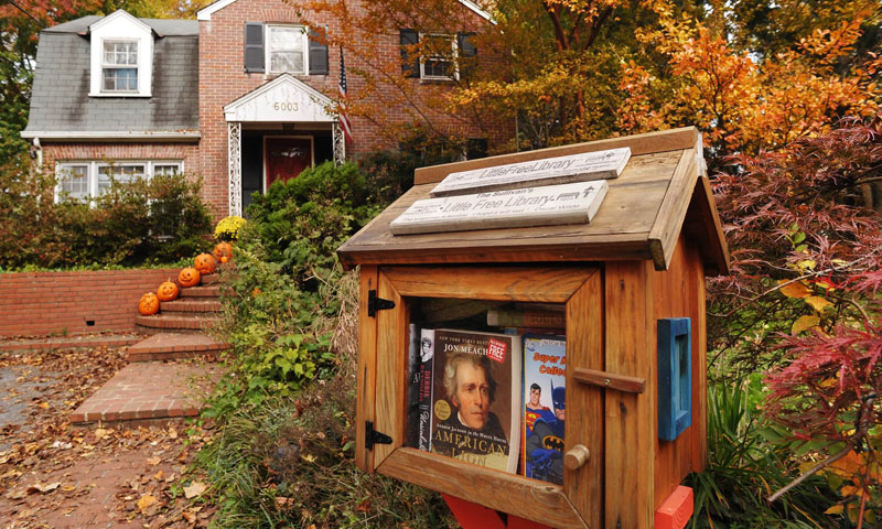 "The home of Kevin Sullivan is seen next to a ""Little Library"" book lending kiosk in Bethesda, Maryland. — Photo by AFP"