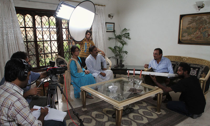 "Pakistani actors Abid Ali, second right, and Javeria Abbasi, third left, act in a scene in the drama serial ""Mere Apne"" or ""My Loved Ones,"" at a studio. — Photo by AP"