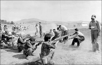 Members of Iran's elite Islamic force execute leftists (1988).