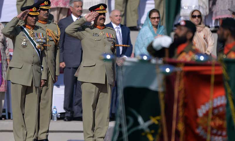 New army chief General Raheel Sharif (C) and outgoing army chief General Ashfaq Kayani (L) salute to soldiers during the change of command ceremony in Rawalpindi on Nov 29, 2013. — Photo by AFP