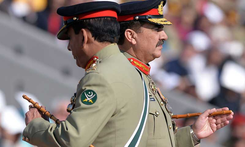 New army chief General Raheel Sharif (R) and outgoing army chief Ashfaq Kayani attend the change of command ceremony in Rawalpindi on Nov 29, 2013. — Photo by AFP