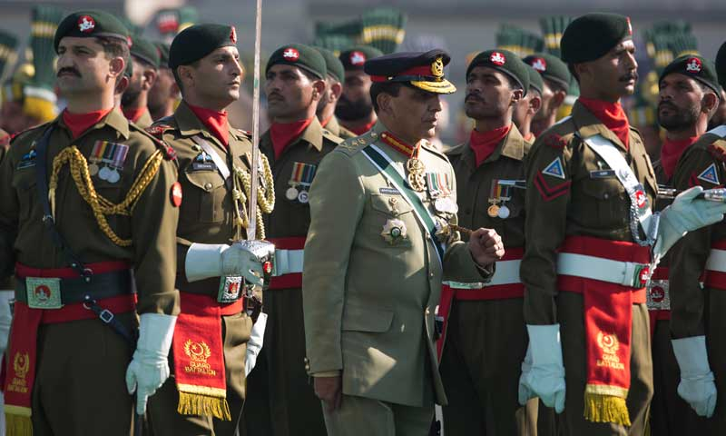 Outgoing army chief Ashfaq Kayani, centre, reviews a guard of honour at a command changing ceremony in Rawalpindi, Nov 29, 2013. — Photo by AP