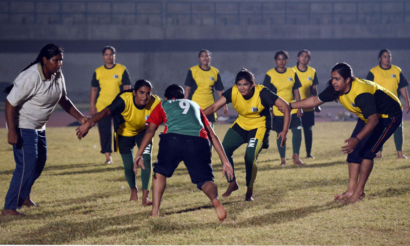 Members of the Pakistan women's Kabaddi team take part in a practice match. —Photo by AFP