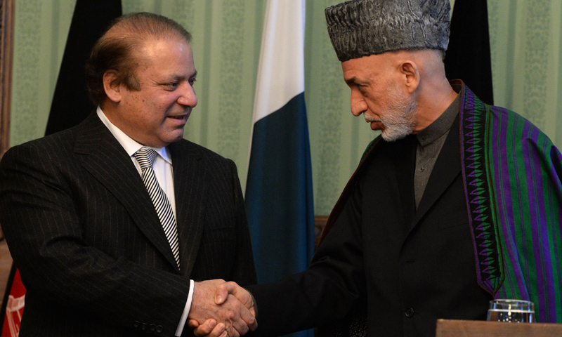 Prime Minister Nawaz Sharif shakes hands with Afghan president Hamid Karzai (R) at the Presidential Palace in Kabul on Nov 30, 2013.—AFP Photo
