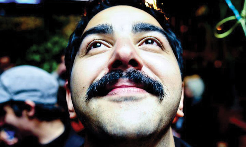 Filmmaker Assad Zulfiqar Khan wears his handlebar moustache as a symbol of resistance.