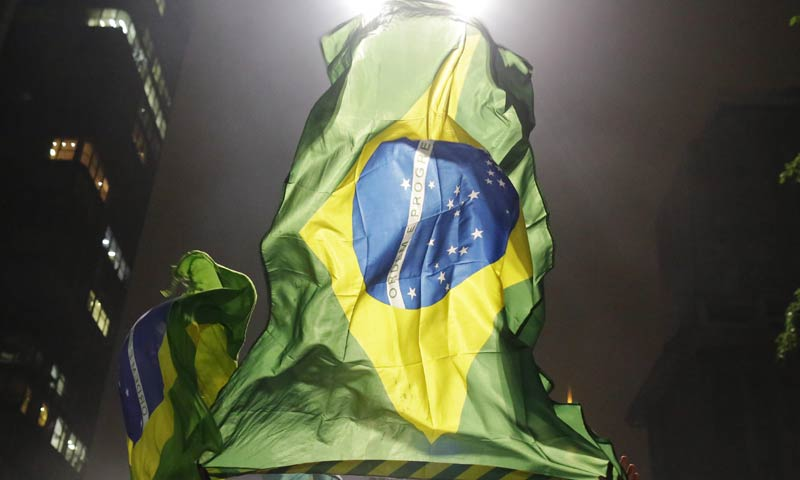 Brazil's media have been quick to highlight clogged airports, poor transport links, thousands of kilometers (miles) between venues and soaring prices. -File photo