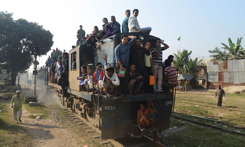 Bangladeshi commuters travel on a train during an ongoing blockade organised by Bangladesh Nationalist Party supporters in Dhaka. Opposition activists derailed a train in Bangladesh Wednesday, killing three people, as part of a campaign against elections due to be held next month. — Photo by AFP