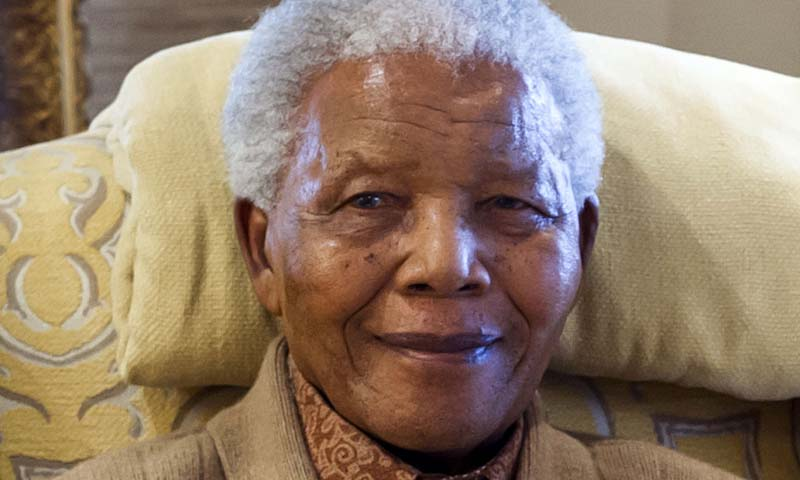 Former South African President Nelson Mandela during a visit by former US president Bill Clinton at his home in Qunu, Eastern Cape, on the eve of his 94th birthday. — Photo AFP