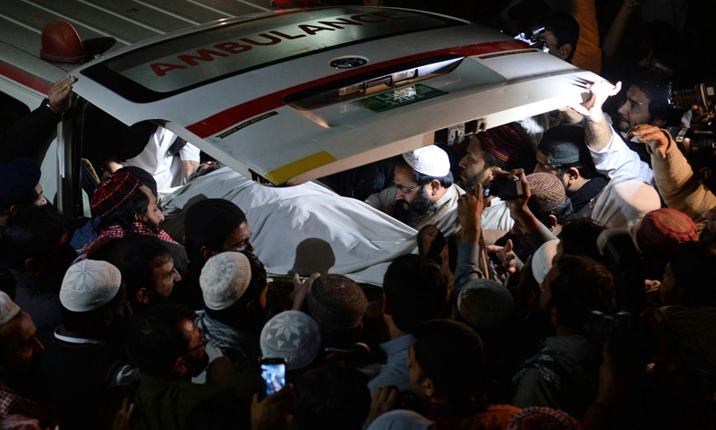 Protesters gathered outside a hospital following the killing of Maulana Shamsur Rehman Muavia, chief of the ASWJ for Punjab province, in Lahore on Dec 6, 2013.—AFP Photo
