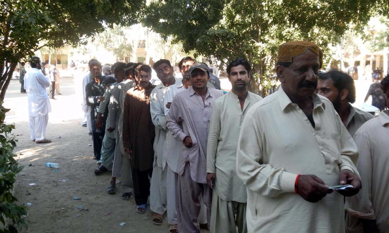 Voters stand in queue to cast their votes outside a polling station  during Balochistan Local Bodies Election, in Hub on Saturday, December 07, 2013.  — Photo by PPI