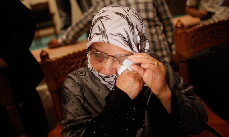 Sanwar Jahan, wife of Abdul Quader Mollah, cries during a media conference in Dhaka. — Photo by Reuters