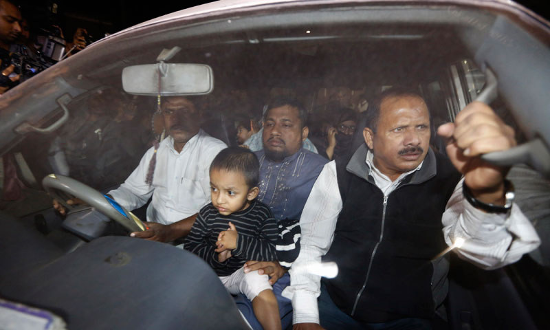Relatives of Abdul Quader Mollah seated in a vehicle come out of Dhaka Central Jail after meeting him in Dhaka. — Photo by Reuters