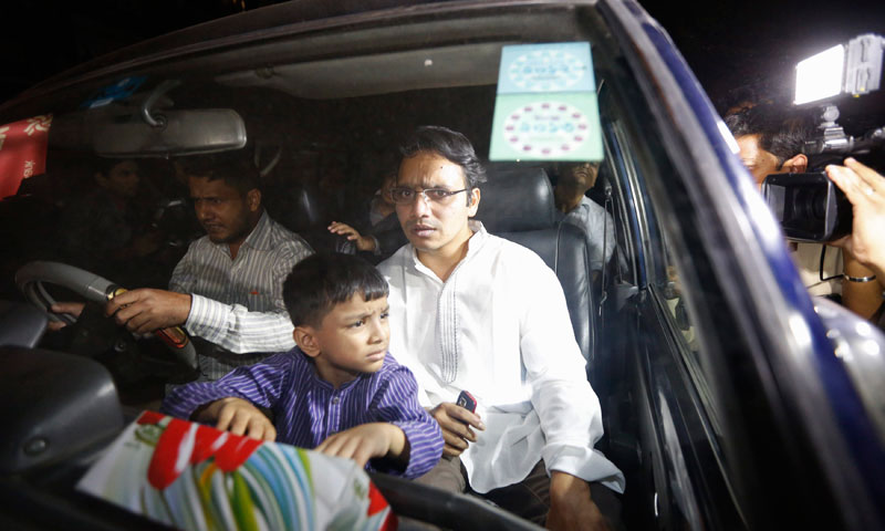 Hasan Jamil (front R), son of Abdul Quader Mollah, sits in a vehicle coming out of Dhaka Central Jail after meeting his father in Dhaka. — Photo by Reuters