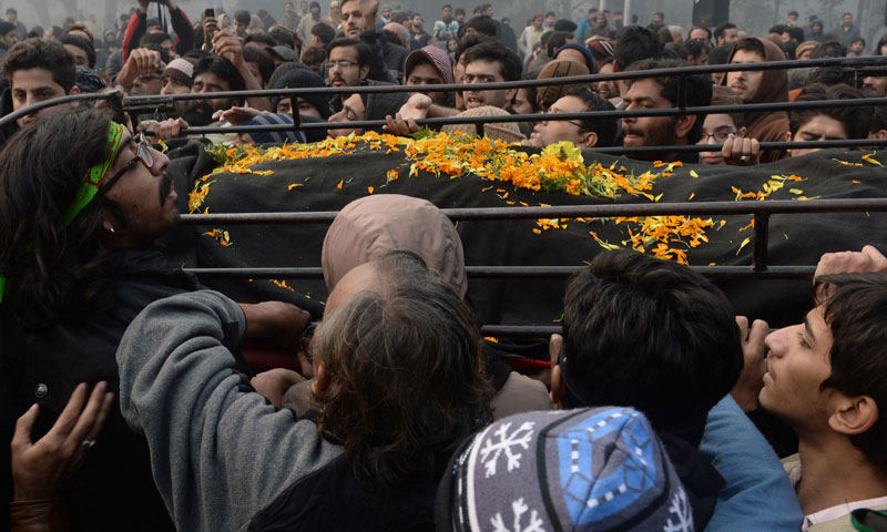 Shia mourners carry the coffin of Shia scholar Allama Nasir Abbas following an attack by gunmen in Lahore on December 16, 2013. — Photo by AFP