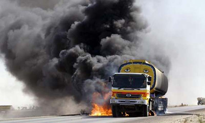 Smoke and flame rise from a burning Nato supplies tanker after gunmen attacked it in Balochistan.  — File Photo by AFP