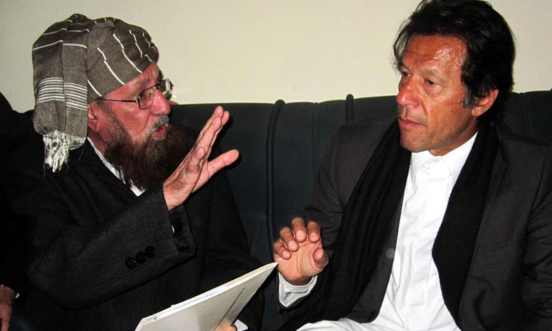 PTI chief Imran Khan exchanging views with Maulana Samiul Haq at Darul Aloom Haqqania on Wednesday. – Photo by Online