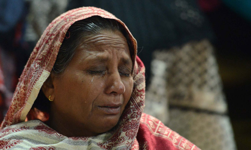 A Pakistani Christian mourns the death of a relative who was killed in the Sept 22 bomb blast at the All Saint's Church, after a service in Peshawar on December 22, 2013. — Photo by AFP