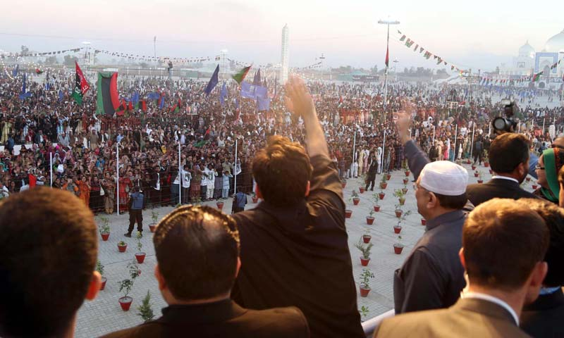 Asif Ali Zardari and Bilawal Bhutto Zardari wave to PPP workers and supporters in Garhi Khuda Bakhsh on Friday, December 27, 2013. – PPI Photo