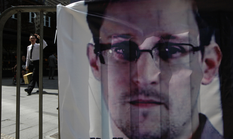 In this photo, a banner supporting Edward Snowden, a former CIA employee who leaked top-secret documents about sweeping US surveillance programs, is displayed at Central, Hong Kong's business district. — AP Photo