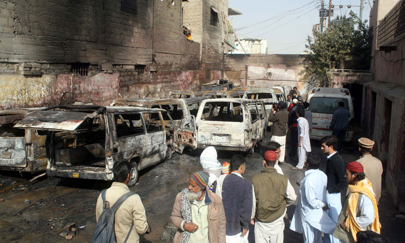 View of burnt ambulances which caught fire due to unknown reason while parking in premises of Old Sabzi Mandi area office of Edhi. — Photo by APP