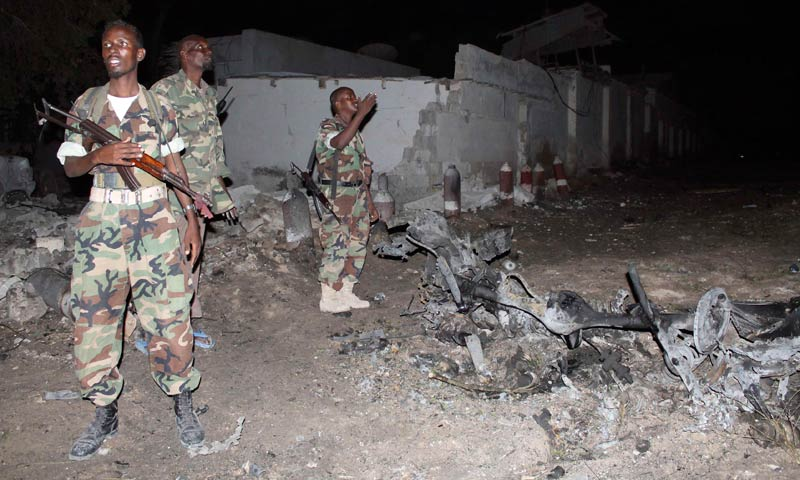 Soldiers assess the scene of an explosion outside the Jazeera hotel in Mogadishu, Jan 1, 2014. — Photo by Reuters
