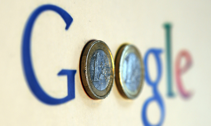 An illustration picture shows a Google logo with two one Euro coins, taken in Munich in this January 15, 2013 file photograph. — Reuters Photo