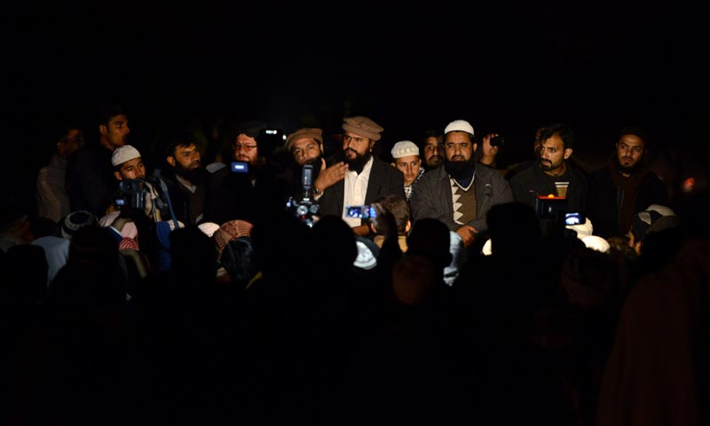ASWJ activists gather after the killing of their leaders at the attack site in Islamabad on January 3, 2014. – AFP