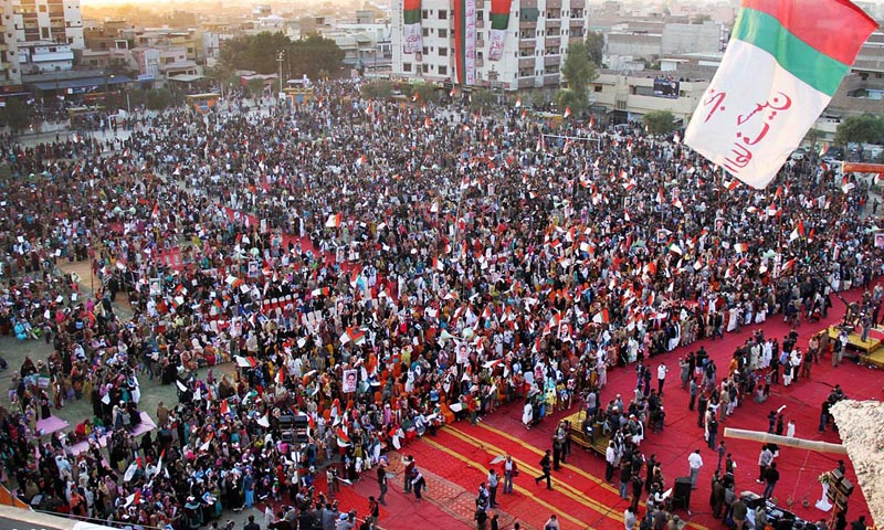 Workers listen to telephonic address of MQM chief Altaf Hussain at Bagh-e-Mustafa Ground Latifabad in Hyderabad on Friday. – Photo by Online