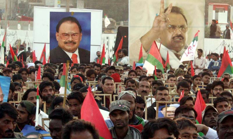 Muttahida Qaumi Movement supporters listen to a telephonic speech by Altaf Hussain during a public gathering in Karachi -APP Photo