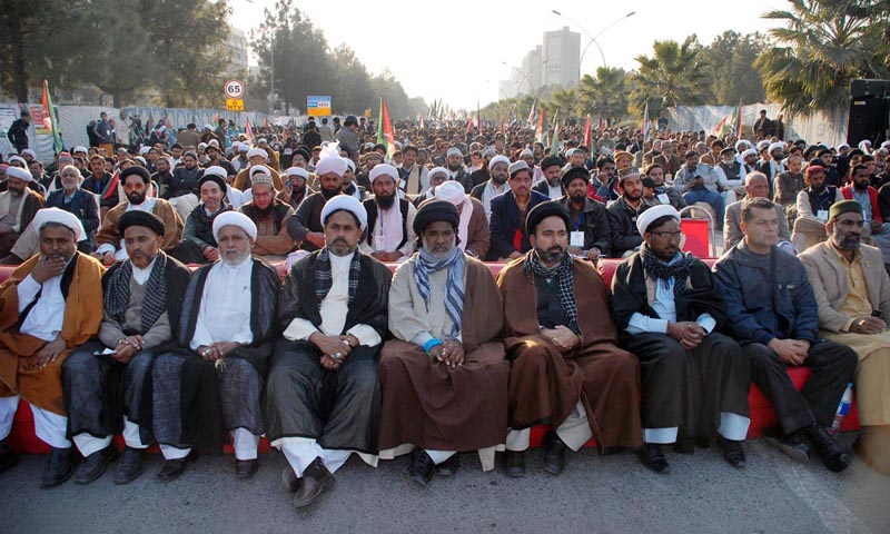 Leaders of different religious parties sitting during National Peace Convention at D-Chowk.— Photo by Online