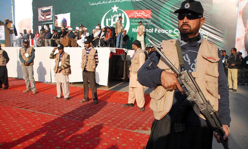 Security person stands alert to avert any untoward incident during National Peace Convention at D-Chowk.— Photo by Online