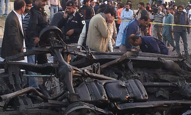 Photo shows the wreckage of slain police officer Chaudhary Aslam's vehicle after a Taliban bombing claimed his life in Karachi, Jan 9, 2014.—Photo by Asif Mehmood