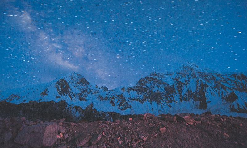 Snow-clad peaks in the starry, starry night. - Photo by Nadir Toosy