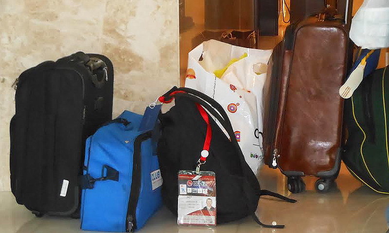 Playing out of a suitcase. A section of the team's luggage in their Dubai hotel. –Photo by Amber