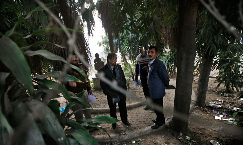 Indian investigators visit a spot which police say is where a Danish tourist was gang-raped in New Delhi, India, Wednesday, Jan15, 2014. — Photo by AP