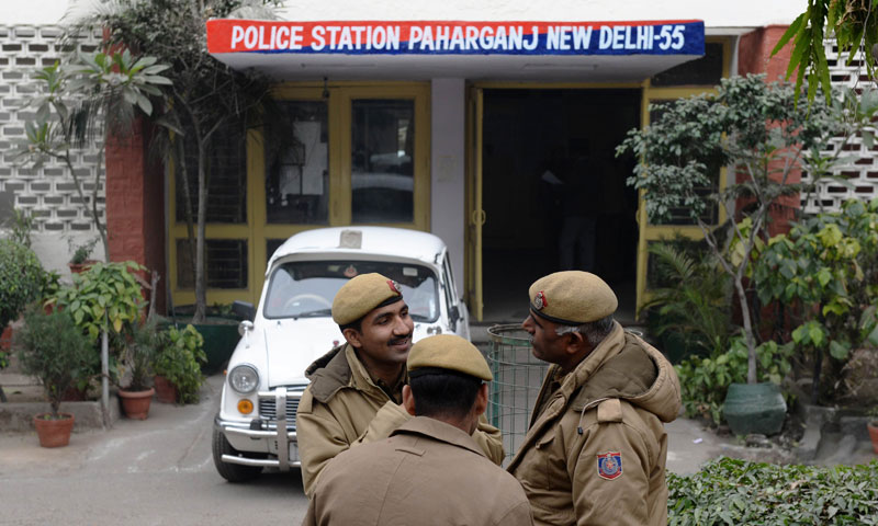 Indian policemen stand in front of the Paharganj police station in New Delhi on Jan 15, 2013 one day after a Danish tourist visiting India was allegedly raped on January 14.  — Photo by AFP