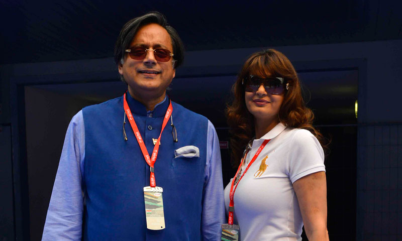 Sunanda Puskhar Tharoor (R), wife of India's Minister of State for Human Resource Development Shashi Tharoor, poses with her husband at the Indian F1 Grand Prix at the Buddh International Circuit in Greater Noida, on the outskirts of New Delhi, October 27, 2013. — Photo by Reuters